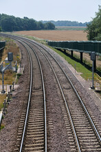 Close View Of Signals & Curve In Freight Train Track Near Felixstowe.  Double Curved Rail Line Towards Felixstowe In Trimley. Close View Showing Signals & Ramp For Horses To Use The Bridge