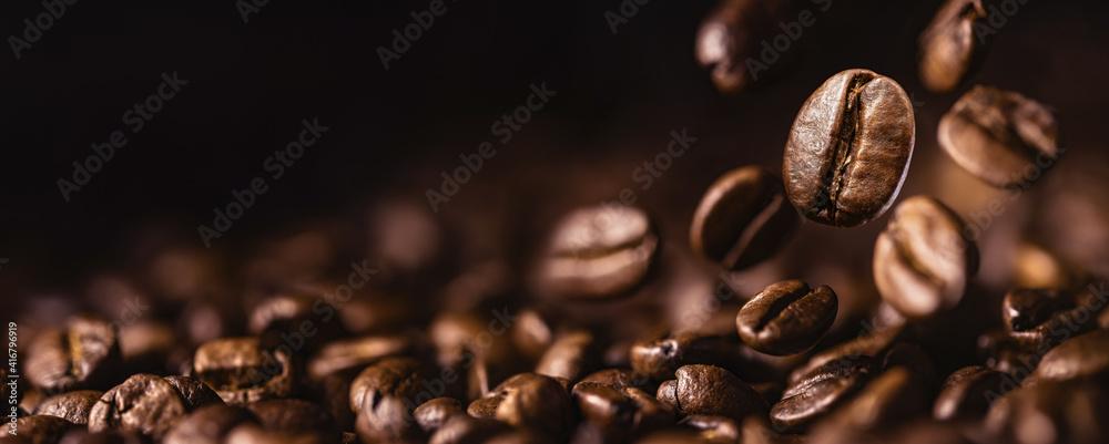 Fototapeta Brown Roasted Coffee Beans Closeup On Dark Background - obraz na płótnie