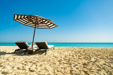 Dream Paradise Beach With Umbrella And Chairs At The Turquoise Mediterranean Sea At El Alamein Near Alexandria, Egypt