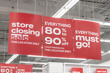 Store Closing And Huge Discount Signs Displayed At A Soon To Be Out Of Business Clearance Sale. Everything Must Go At Up To 90 Percent Off Sale.