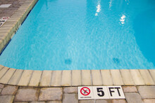 Warning Sign Of No Diving Into The Shallow End Of A Swimming Pool.