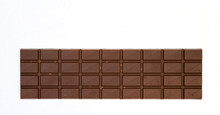 Sweet And Delicious Whole Chocolate Bar Is Lying On White Background, Photo Taken From Above