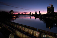 Reflection Of Boston Skyline On The Charles River At Sunrise