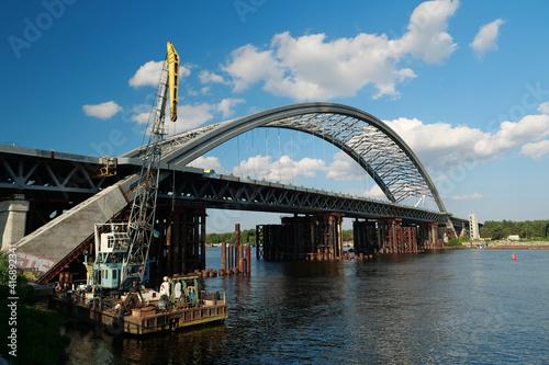 Obraz na plátně Construction of a new big bridge over a Dnieper river in Kyiv, Ukraine