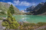 A picturesque lake in the Altai mountains on a summer morning