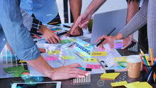 Close Up Creative Designer Use Augmented Reality App Brainstorming About Branding On Desk At Modern Office.Creative Digital Development Agency