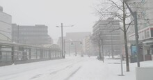 Snowstorm Blizzard And White Winter Scenery In German City Brunswick With Tram Station At Main Street Stock Footage