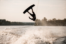 Young Healthy Athletic Guy Makes Incredible Somersault On Wakeboard