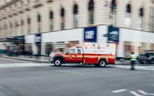 New York City, USA - March 18, 2017: FDNY Ambulance Flashing Lights Siren Blasting Speed Through Midtown Rush Hour Traffic In Manhattan.