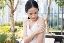 Asian Woman Being Inoculated By Getting Vaccinated Immunity With Bandage On Her Upper Arm, Concept Of Universal Vaccine Rollout Plan, Inoculation, Vaccination, Adverse Effect Of Side Effect Of Vaccine