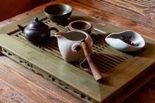 Tea Table. Broken Dishes. Brown Chinese Teapot