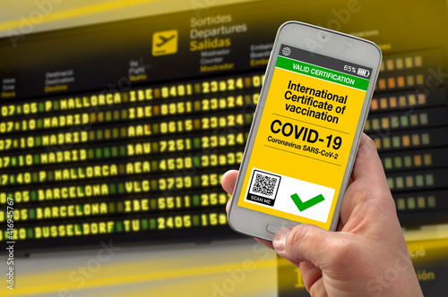 Smartphone with international certificate of vaccination against covid-19 with airport background