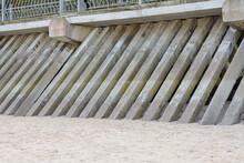 Concrete Piles Fortification On Seashore. Construction Of Pedestrian Road Raised Along Coast