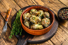 Artichoke Hearts Pickled In Olive Oil. Wooden Background. Top View