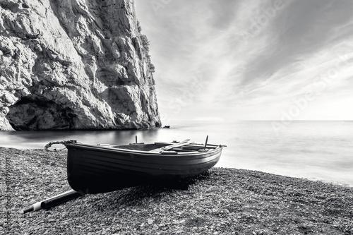 Canvas Print A fishing boat adrift on the beach of the Amalfi coast, black and white mood