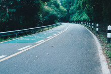 Road With Bicycle Lane In The Country With Nature Surrounding.