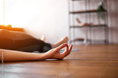 Young attractive woman practicing yoga, Savasana pose Fotobehang