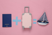 Travel Concept. Equation With Passport, Luggage And Yacht On Pink Background