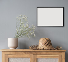 Blank Picture Frame Mockup On Gray Wall. Scandinavian Living Room Design. View Of Modern Style Interior. Home Staging And Minimalism Concept