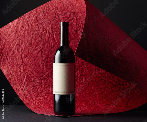 Unopened red wine bottle with empty label. © Igor Normann