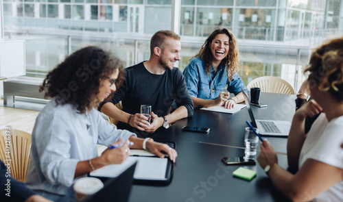 Canvas Print Business people smiling after a productive meeting