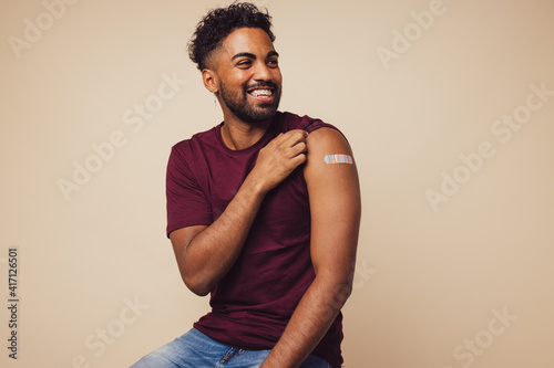 Man smiling after receiving vaccination Wallpaper Mural