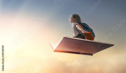 child flying on the book © Konstantin Yuganov