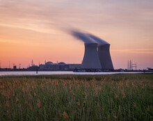 Sunset Over The Nuclear Reactor Of Doel In The Port Of Antwerp, Belgium.