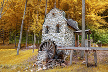 A Water Mill Against The Backdrop Of A Beautiful Autumn Park.