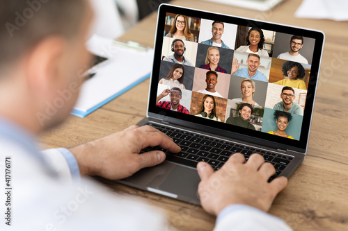Unrecognizable Businessman Making Video Call On Laptop With Multiethnic Colleagu Fotobehang