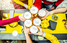 Group Of People Toasting A Beer In Brewery Pub - Friends Having Fun Drinking Alcohol At Bar Restaurant - People, Food And Drink Concept