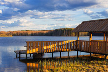 Wooden Arbor And Pier On  Shore Of  Spring Lake