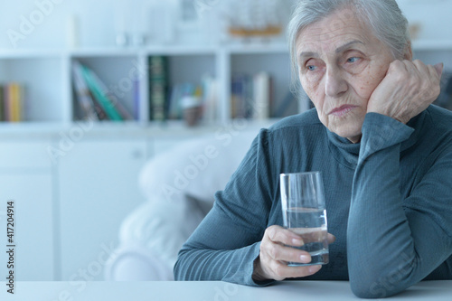 close-up portrait of a sad elderly woman Fototapeta