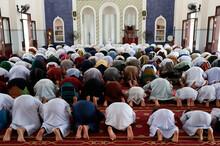 Masjid Ar-Rohmah Mosque.  Men At The Friday Prayer (salat).  Chau Doc. Vietnam.  21.09.2018