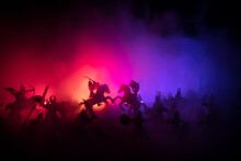 Medieval Battle Scene With Cavalry And Infantry. Silhouettes Of Figures As Separate Objects, Fight Between Warriors On Sunset Foggy Background.