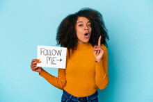 Young African American Curly Woman Holding A Follow Me Placard Having Some Great Idea, Concept Of Creativity.