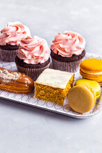 A Selection Of Fancy Cream Cakes On A Tray