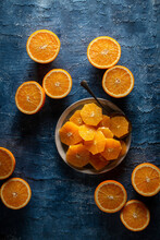 Flat Lay Of Plated Orange Slices On A Blue Background