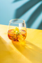 Whiskey Glass With Ice Cubes And Thyme