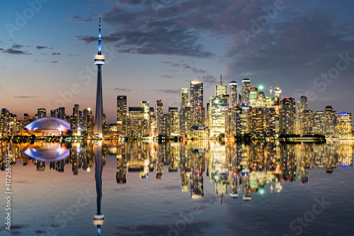 Fototapeta premium Reflection of the night city skyline of Toronto, Ontario, Canada