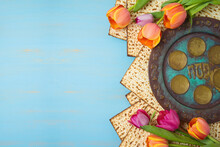 Jewish Holiday Passover Celebration Concept With Seder Plate, Matzah And Tulip Flowers On Wooden Table. Pesach Background.