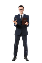 Male Lawyer With Scales Of Justice And Book On White Background