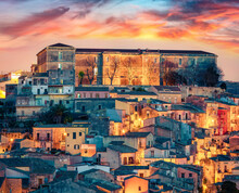 Сharm Of The Ancient Cities Of Europe. Splendid Summer Cityscape Of Ragusa Town. Colorful Sunset On Sicily, Italy, Europe. Traveling Concept Background.