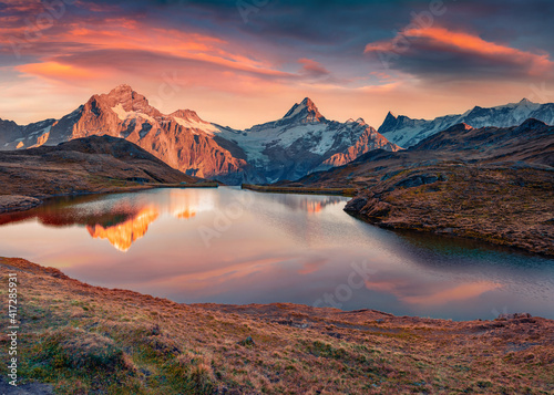 Astonishing morning view of Bachalp lake (Bachalpsee), Switzerland. Impressive autumn sunrise in Swiss Alps, Grindelwald, Bernese Oberland, Europe. Beauty of nature concept background.