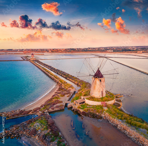 Aerial landscape photography. Spectacular spring sunset on  popular tourist destination - Imbarcadero Storico Mothia. Splendid evening scene of Sicily, Italy, Europe. Traveling concept background.