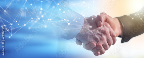 Fotografia Two men shaking hands in office; panoramic banner