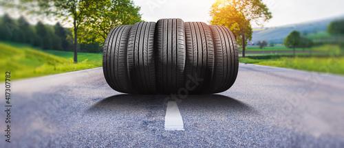 Fototapeta summer car tires on the street outside obraz