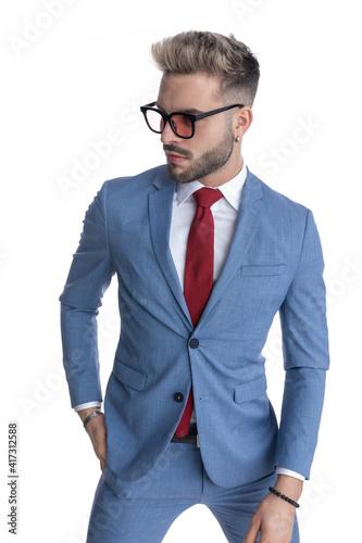 handsome businessman sticking one hand in pocket © Viorel Sima
