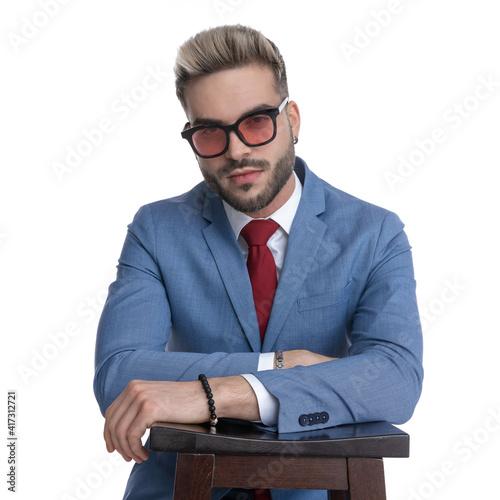 handsome seductive businessman resting on a chair © Viorel Sima