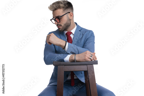 sexy businessman sitting on a chair, resting his arms © Viorel Sima